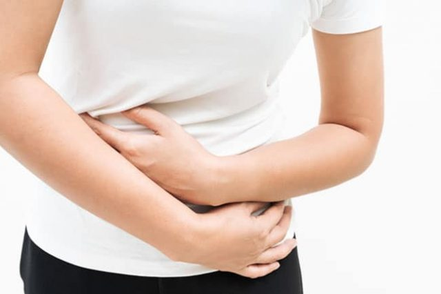Young woman suffering from abdominal pain feeling stomachache, s